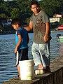 Man and Boy Fishing at Waterfront - Flores - Peten - Guatemala (15684341050).jpg
