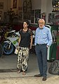 Man and woman in front of motorcycle garage, Esino Lario.jpg