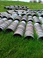 Maple buckets drying in field (4572055864).jpg