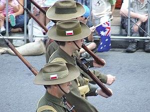 Unit Colour Patch - Marchers in World War II Australian uniforms, wearing the colour patch of the 2/8th Battalion.