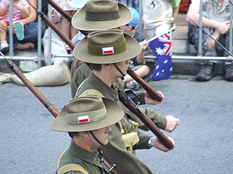 Unit Colour Patch - Marchers in World War II Australian uniforms, wearing the colour patch of the 2/8th Battalion.
