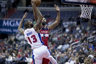 Marcus Morris (basketball) - Morris battling for the ball with his brother Markieff Morris of the Washington Wizards.