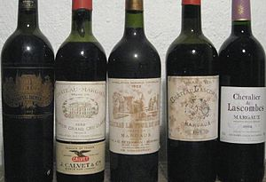 Ullage (wine) - An assortment of aged Bordeaux wine with various ullage levels.