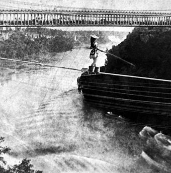 Maria Spelterini walking a tightrope across Niagara Gorge Maria Spelterini at Suspension Bridge.jpg