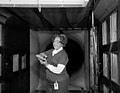Mary Jackson in a wind tunnel with a model at NASA Langley - Original.jpg