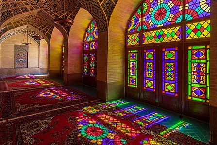 Colored windows seen from the interior of the Nasir-ol-Molk Mosque, Shiraz district of Gowad-e-Arabān, Iran.