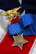 Michael A. Monsoor's Medal of Honor pictured with the Navy Special Warfare (SEAL) Trident.