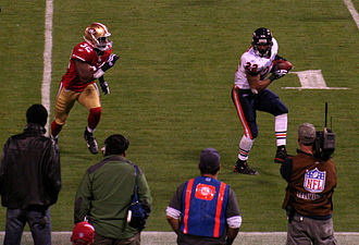 Matt Forte - Forte attempts to escape from San Francisco 49ers safety Michael Lewis in a 2009 meeting