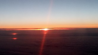 Midnight sun - Midnight Sun seen from airplane while passing Greenland