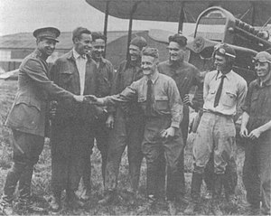 St. Clair Streett - Brigadier General Billy Mitchell (left) shakes hands with St. Clair Streett, hatless, wearing a shirt and tie, 1920