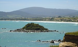 Orepuki - Monkey Island, Orepuki, Southland, New Zealand. Orepuki township in background