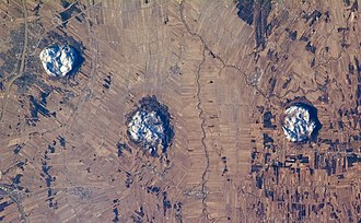Monteregian Hills - Three of the central Monteregian hills (from left: Mont Saint-Hilaire, Mont Rougemont and Mont Yamaska) viewed from space.