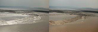 Polarization (waves) - Effect of a polarizer on reflection from mud flats. In the picture on the left, the horizontally oriented polarizer preferentially transmits those reflections; rotating the polarizer by 90° (right) as one would view using polarized sunglasses blocks almost all specularly reflected sunlight.
