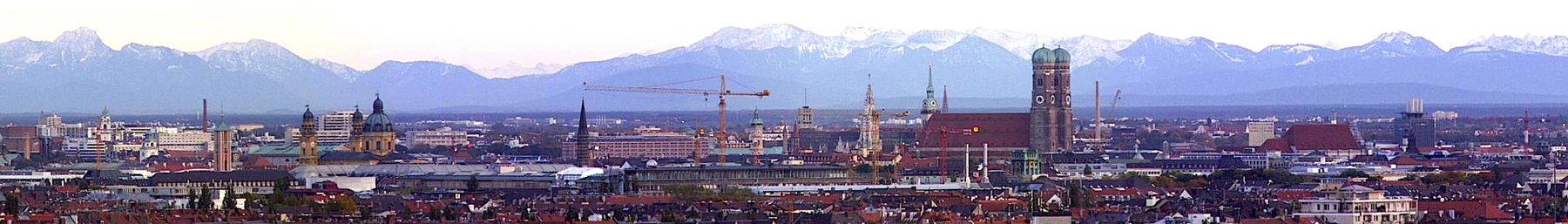 A panorama of Munich with the Frauenkirche against the backdrop of the Alps
