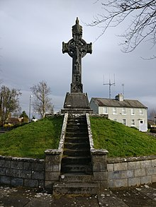 A photograph of the cross on the mound in Murroe