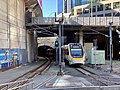NGR733 train emerging from rail tunnel at Central railway station, Brisbane, Queensland.jpg