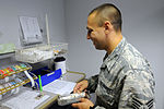NJ ANG aerospace medical technicians administer immunizations to patients on Ramstein Air Base 150806-Z-IM486-007.jpg
