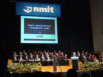 Melbourne Polytechnic - Academic staff of Northern Melbourne Institute of TAFE (NMIT) on the stage at the 2009 Graduation Ceremony, with CEO Brian MacDonald speaking