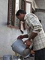 Nepalese dairy man (6896118811).jpg