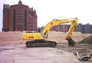 New Holland Construction - A famous New Holland excavator E 215 fitted with tilting bucket.