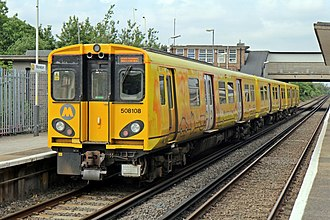 British Rail Class 508 - 508108 at Moreton displaying one of the Merseyrail Good Communications liveries.