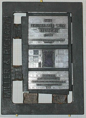 "Quoin (printing) - A single-page ""forme"" for printing the front page of the New Testament of the Christian Bible. The black frame surrounding it is the ""chase"", and the two objects each on the bottom and left side are the ""quoins""."