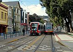 New and old Muni Metro trains at Duboce and Church, January 2018.JPG
