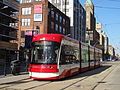 New streetcar 4404 heading south on Spadina, near King, 2014 12 20 (3) (15451027244).jpg