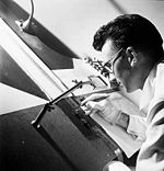 Experimental animator Norman McLaren drawing directly on film in 1944