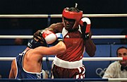 Olanda Anderson (Red) tries to land a punch against Rudolf Kraj, 2000.jpg
