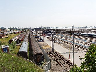 Old Oak Common TMD - View from western end of depot in 2007, showing: (far left) residual GWR buildings; (left) Coronation Carriage Sidings; (centre) dividing fence; (right) Great Western Railway depot