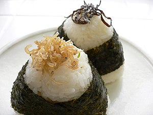 Onigiri - Two onigiri, or rice balls, on a plate