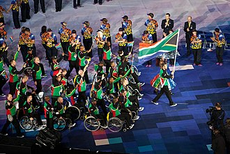 Pistorius carrying the flag at the opening ceremony of the 2012 Summer Paralympics Oscar Pistorius leading South Africa's Paralympic Team in the opening ceremony of the 2012 Summer Paralympics in London - 20120829.jpg