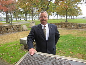 Theodore Roosevelt Memorial Park - Theodore Roosevelt re-enactor Joe Wiegand beside the Theodore Roosevelt Monument Assemblage in Theodore Roosevelt Memorial Park