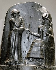 Iraq - Hammurabi, depicted as receiving his royal insignia from Shamash. Relief on the upper part of the stele of Hammurabi's code of laws.