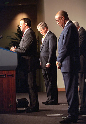 J. C. Watts - President Bush bows his head as Watts leads a prayer before the swearing-in ceremony for Rod Paige (right) as Secretary of Education on January 24, 2001.