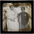 Parsi woman and son at an unknown location in India (c. 1900).jpg