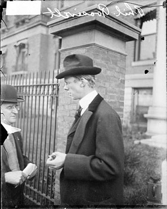 Philip Roosevelt - Philip Roosevelt, first cousin once removed of Theodore Roosevelt, standing at the gate outside Mercy Hospital where his cousin was taken after a 1912-10-14 assassination attempt (1912-10-15)