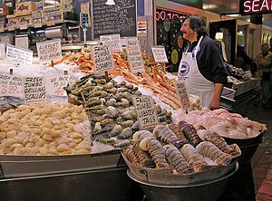 Fishmonger - A fishmonger in Pike Place Market on the waterfront of Seattle.