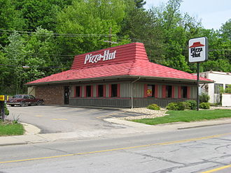 Pizza Hut - Athens, Ohio: distinctive roof and older white sign used before 1999, typical of U.S. Pizza Hut restaurants