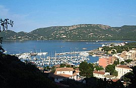 A view of Porto-Vecchio, looking across the Gulf of Porto-Vecchio, with the marina in the foreground and the ferry pier beyond
