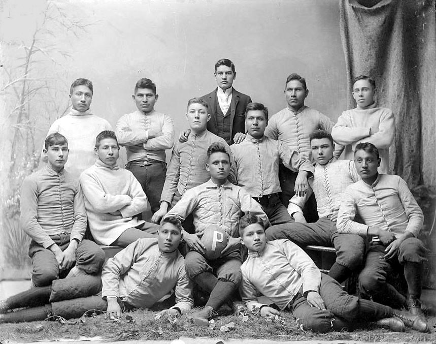 "Portrait of College Football Team, The ""Pirates,"" in Partial Uniform, and with Man in Business Suit 1879"