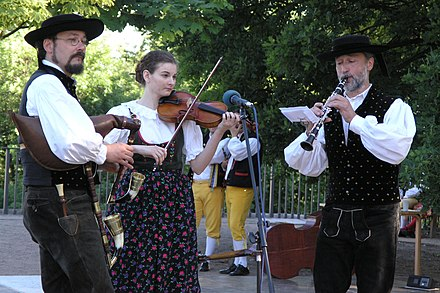 Folk music band from southern Bohemia wearing local folk costumes Praha - X. Narodopisna slavnost v Kinskeho zahrade 075.jpg