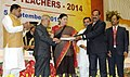 Pranab Mukherjee presenting the National Award for Teachers-2014 to Shri Dasari Venkata Sreemannarayana, Andhra Pradesh, on the occasion of the 'Teachers Day'.jpg