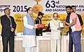 Pranab Mukherjee presenting the Rajat Kamal Award to the Director Dribbling with Their Future, Rep Shri Jacob Varghese for Best Exploration Adventure Film, in Non-Feature Film Section.jpg