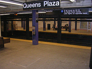 Queens Plaza (IND Queens Boulevard Line) - View of the Jamaica and 71st Avenue bound platform from the Manhattan bound platform, with a Jamaica Center bound  E express train leaving the station.
