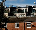 Quinney Crescent with flats on Moss Lane West behind in Moss Side, Manchester - panoramio.jpg