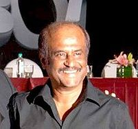 Rajinikanth is smiling at the camera