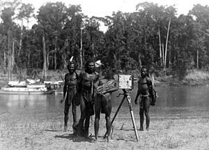 Ramu - Ramu villagers investigating a camera during an Australian expedition in the 1930s