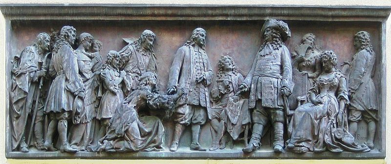 Relief by Johannes Boese, 1885: The Great Prince-elector of Brandenburg-Prussia welcomes arriving Huguenots Relief 1885.jpg